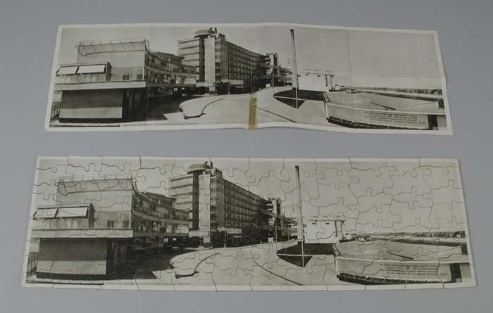 Langwerpige puzzel van de Van Nelle fabriek, met legvoorbeeld