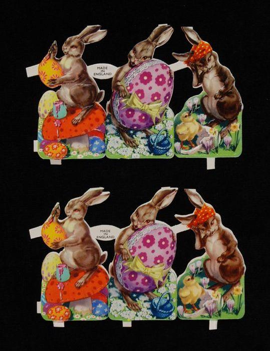 """Twee series poëzieplaatjes 'Pasen', drie aan elkaar verbonden plaatjes van paashazen met versierde eieren, twee keer dezelfde serie, kleurendruk op papier, """"De Gruyter's Snoepje van de Week"""""""