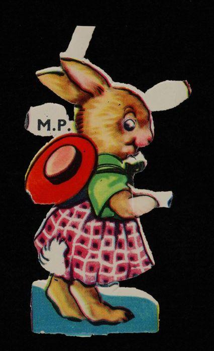 """Poëzieplaatje 'Pasen', haasje met roze geruit rokje en groen jasje, kleurendruk op papier, """"De Gruyter's Snoepje van de Week"""""""